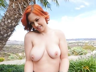 Sporty Ginger-haired Vixen Edyn Opens Up And Strips Outdoors